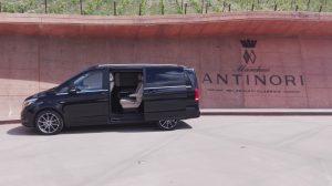 Luxury minivan in front of the Antinori winery entrance at Bargino
