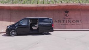 Luxury minivan in front of the Antinori winery entrance at Bargino